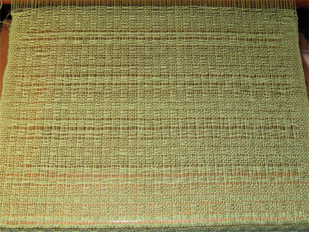 green-wool-lace-on-loom