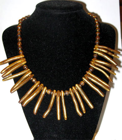 gold coral sticks necklace