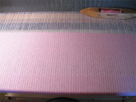 handwoven baby blanket on the loom