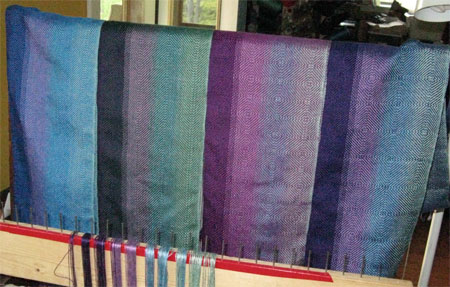 handwoven color blending scarves, hanging