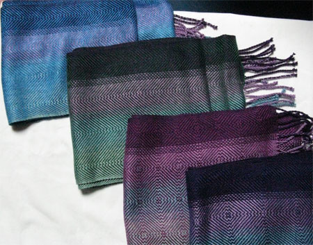 folded handwoven color blending scarves