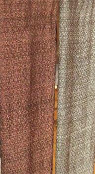 2 handwoven silk scarves on rack