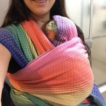 infant in a handwoven baby wrap