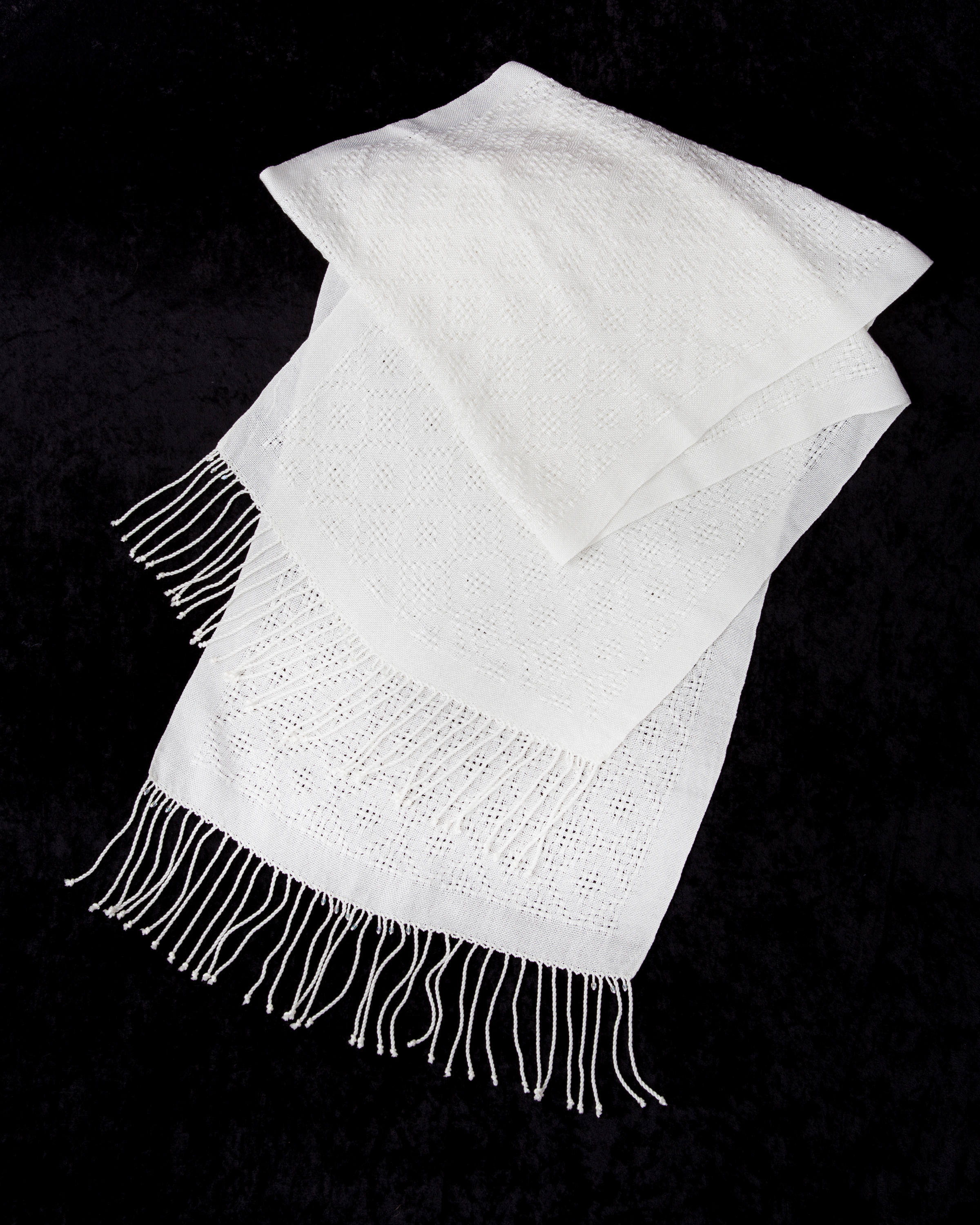 white shawl with beaded fringe