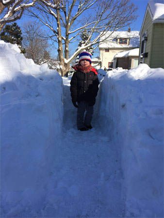 child in the deep snow
