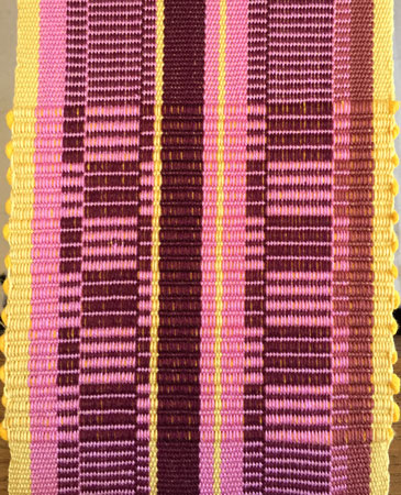 pink rep weave on the loom