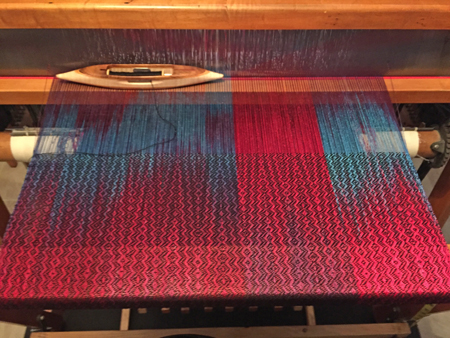 hand painted rayon shawl on the loom with black weft