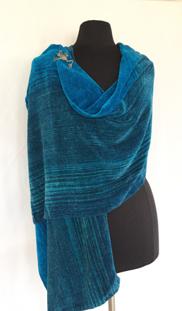 into the blue rayon chenille shawl, draped