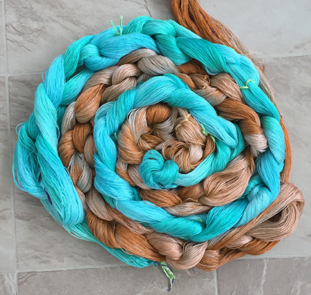 turquoise and terra cotta yarns chained together