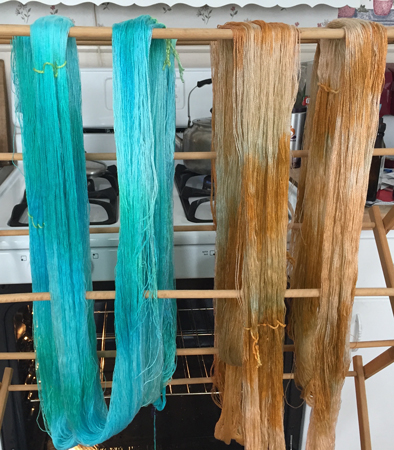 turquoise and terra cotta yarn drying
