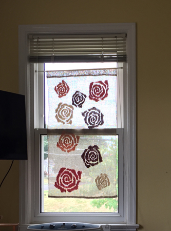 roses hung in the window