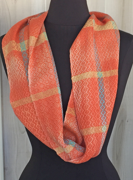 handwoven coral & turquoise cowl, orange weft, down