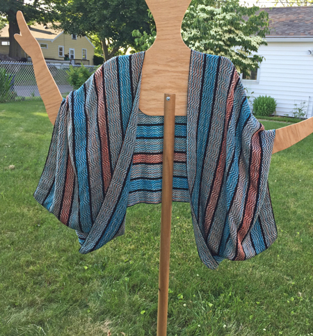 handwoven jacket with handpainted yarn in turquoise, coral, and black