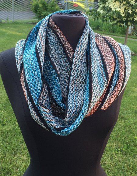 handwoven cowl in handpainted turquoise and coral yarn
