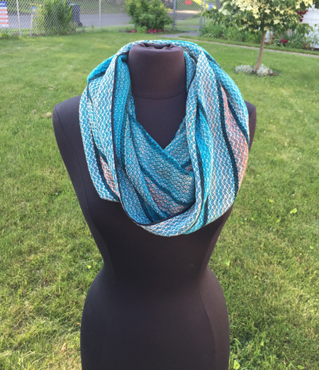 handwoven cowl in turquoise and coral handpainted yarn