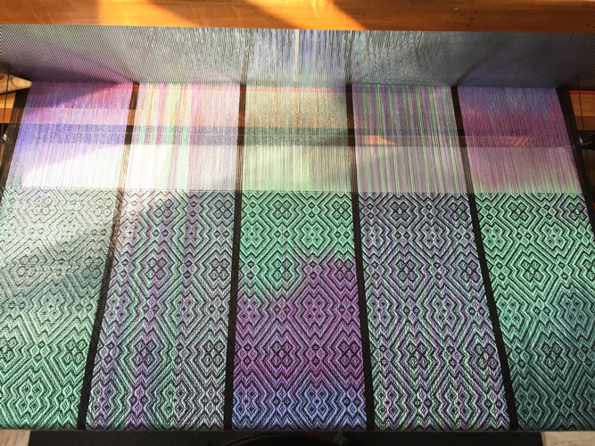 weaving brilliant gemtones with black weft