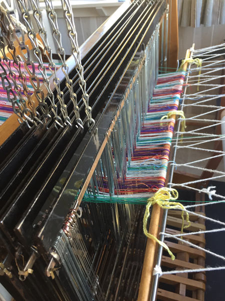 VERY close to the end of the warp on the loom