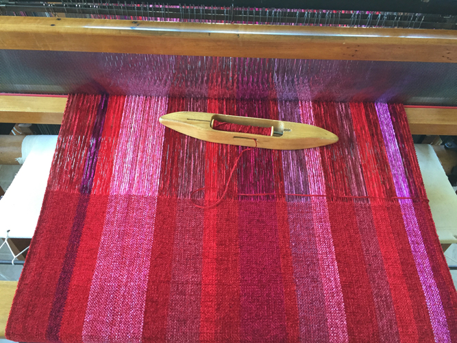 handwoven red striped rayon chenille wrap, on the loom
