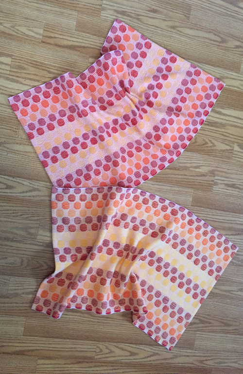 handwoven polka dot towels with peach and yellow wefts