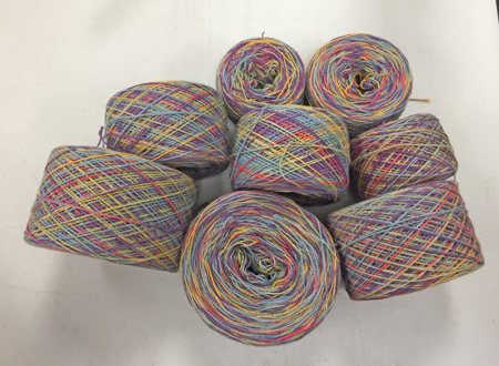 hand painted yarn wound into cakes