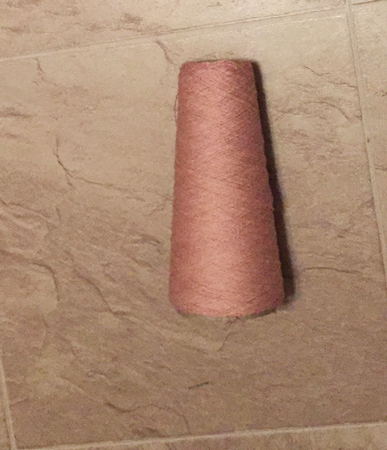 pink-ish taupe yarn on cone