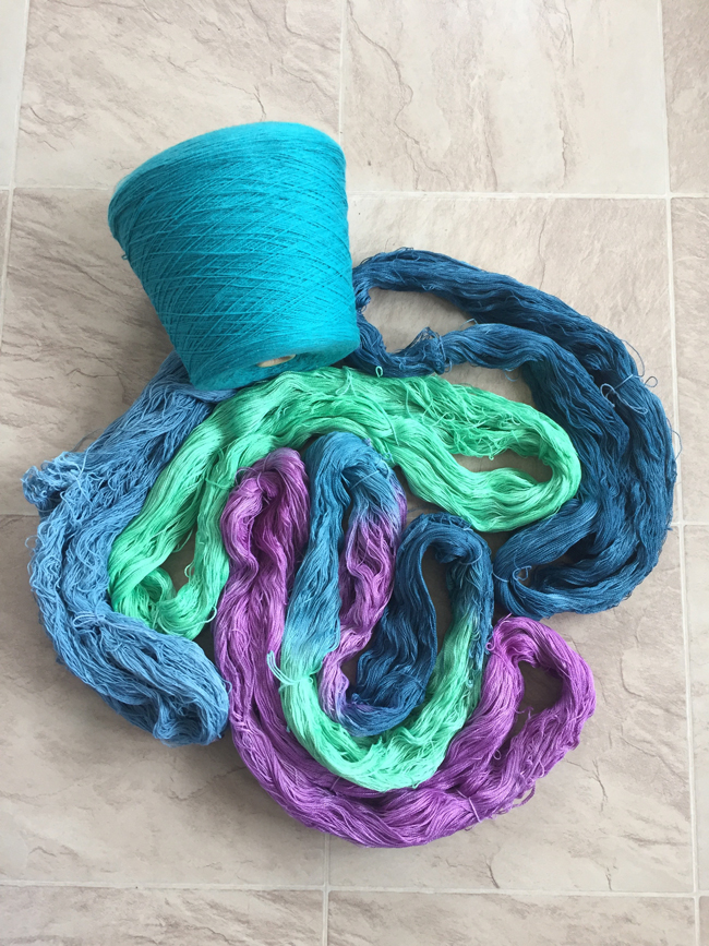hand dyed skeins with a commercial cone