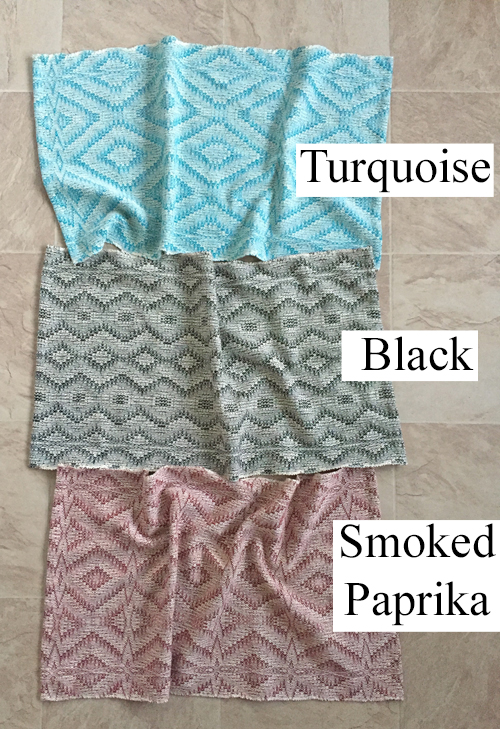 turquoise, black, and smoked paprika towels