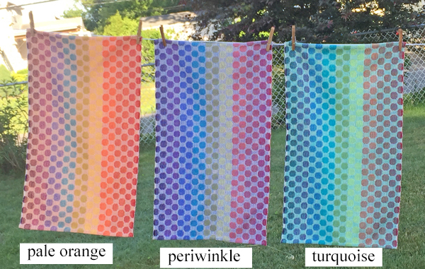 orange, periwinkle, and turquoise towels