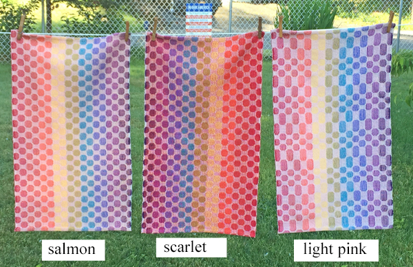 salmon, scarlet, and pink towels