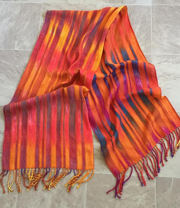 sunrise sunset shawl with orange laid flat