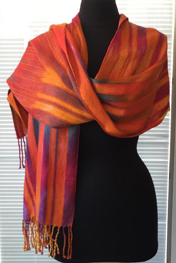 sunrise sunset shawl with orange on mannequin