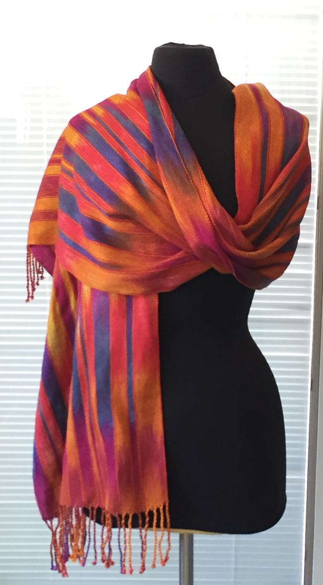 sunrise sunset shawl with dusty rose weft-on mannequin