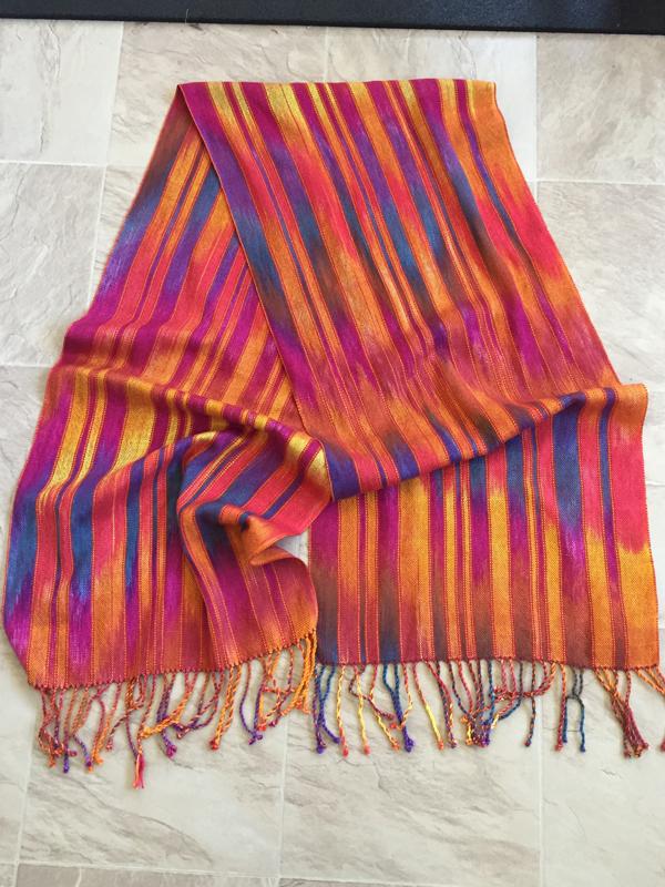 sunrise sunset shawl with rose laid flat